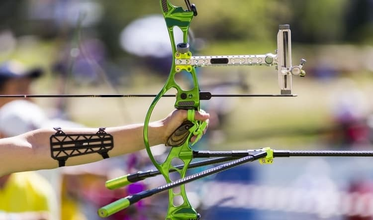 why olympic archers spin their bows